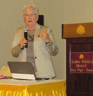 Photo of Ilene Zeitzer providing speaking during a training in Myanmar